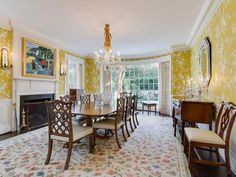 Traditional Dining Room with Crown molding, Carpet, Wall sconce, Cement…