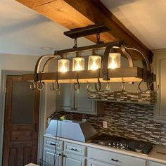Clear seedy glass adds to the industrial inspired look of this bronze pot rack chandelier. 36 wide x deep x 20 high. Canopy is 13 wide x 4 deep x 2 high. Style # at Lamps Plus. Classic Kitchen, New Kitchen, Kitchen Decor, Kitchen Ideas, Kitchen Inspiration, Kitchen Modern, Kitchen Tips, Kitchen Contemporary, Boho Kitchen