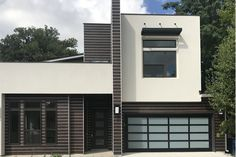 Modern and contemporary home. RusticSeries wood look lap siding with easytrim reveals. Beautiful architectural design inspiration features.