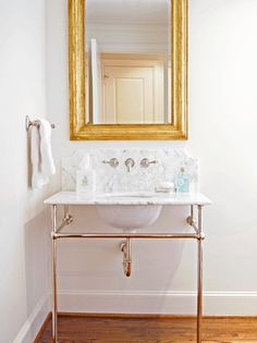 Try wall mounting your bathroom faucets for more room // Storage Solutions