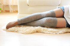 Hand-knit legwarmers in a delicate pattern.