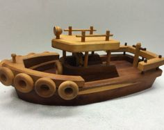 Resultado de imagen para tren y barco de madera de juguete