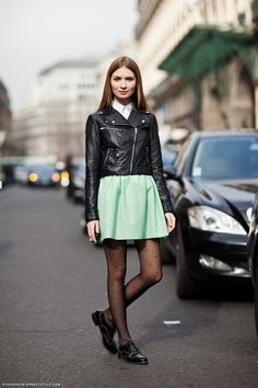 Russian blogger Maria (Kyklamasha) photographed in Paris wearing a leather jacket, collared shirt, mint green skirt with swiss dot tights and black oxford flats. | Photography by Caroline Blomst / Stockholm Streetstyle #pastel #streetstyle
