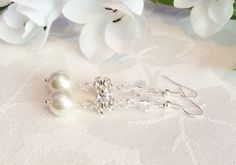 Ivory Pearl Earrings Pearl Earrings Pearl Jewelry Bridesmaid Earrings Bridesmaid Jewelry Bridesmaid Gift Wedding by InfinityByClaire on Etsy https://www.etsy.com/listing/239305779/ivory-pearl-earrings-pearl-earrings