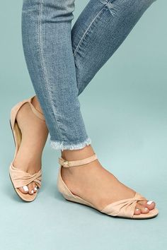 The Maryanna Blush Suede Wedge Sandals are a cute and comfortable pick for every special occasion! Vegan suede shapes a twisted, peep-toe upper and matching adjustable ankle strap (with gold buckle).