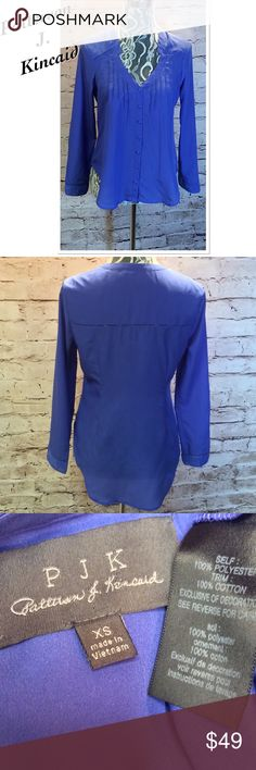 PATTERSON J. KINCAID HIGH/LOW PURPLE BLOUSE/TOP Gorgeous blouse with a hi/low hem and delicate cutouts around the neck area and bottom of sleeves. Excellent condition Patterson J. Kincaid Tops Blouses