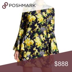 NWOT Floral Bell Sleeve Swing Dress Gorgeous black and yellow floral print swing dress with wide bell sleeves. V-neck with choker neckline secured by two back buttons. Pull on styling. Soprano Dresses