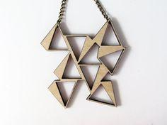 Piramyd necklace. Wood by indomina on Etsy, $22.00. Laser cut jewelry