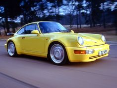 yellow Porsche 964 turbo 2