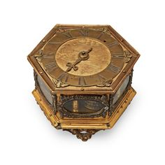 "A BAROQUE 17TH CENTURY TABLE CLOCK. Brass. The clockwork with worn signature ""Jacob Erha Horn"" (?). Length 14, height 9,5 cm"