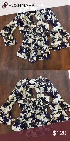 Parker romper size XS Such a fun piece. Has key hole back and front has option to button or keep open. Sleeves are flared and layered. Has a cinched waist. Parker Other