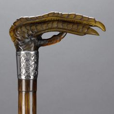 A horn and silver mounted claw walking cane, by James Smith & Brothers, Birmingham 1911 Handmade Walking Sticks, Wooden Walking Sticks, Walking Sticks And Canes, Walking Canes, Custom Canes, Parasols, Umbrellas, Cane Handles, Cane Stick