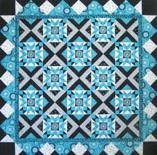 Rhythm & Blues Quilt ~ FREE pattern download http://www.redroosterfabrics.com/contentmgr/showdetails.php/id/7367