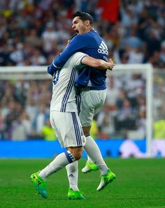 James Rodriguez of Real Madrid celebrates with Alvaro Morata as he scores their second goal during the La Liga match between Real Madrid CF and FC Barcelona at Estadio Bernabeu on April 23, 2017 in Madrid, Spain.