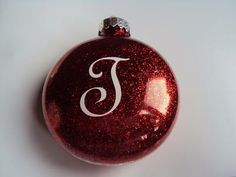 homemade christmas ornament - initial on back: I made this homemade Christmas ornament (glitter ball) for my new nephew. He will be 4 months old at Christmas this year.  Materials:  Clear glass ornament