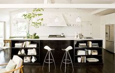 Closing out this post with one more black and white stunner. I am living the open shelving on the island and how expansive the island is...such a great prep/serving space. the open ceiling adds an airiness to the whole space while the black island grounds everything down. I also am loving the modern barstools, a nice unexpected addition. Source.