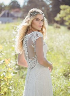 Corded lace adorns this soft V-neck gown with illusion straps and cap sleeves. Jersey lining means added comfort for the carefree bride, no matter where the setting is for her dream wedding. https://www.lillianwest.com/lillian_west/6482