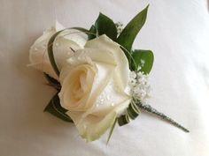 Elegant cream roses buttonhole x