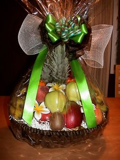 Custom Fruit Basket..to impress the recipient!  made by: EXQUISITE BASKET EXPRESSIONS http://www.HawaiiBasket.com