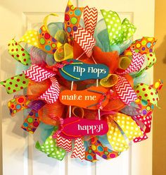 Nothing says summer like this fun flip flop wreath! It measures approximately 24x24. It features lots of multi colored ribbon, including chevron and polka dot. Also will include deco flex tubing (not pictured here) and a large wooden flip flop with curly-q ribbons! Please feel free to ask any questions, and please remember some minor details may vary as once originals are sold each wreath ordered is recreated. Thank you for visiting my shop and have a wonderful day