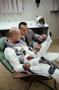 S65-59977 (15 Dec. 1965) --- Astronauts Thomas P. Stafford (foreground), Gemini-6 prime crew pilot; and Alan B. Shepard Jr., chief, Astronaut Office, Manned Spacecraft Center, look over a Gemini mission chart in the suiting trailer at Launch Complex 16 during the Gemini-6 prelaunch countdown at Cape Kennedy, Florida. Photo credit: NASA or National Aeronautics and Space Administration