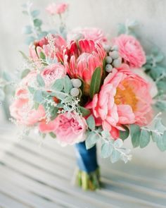 Like the flowers but different color than the pink.Protea. Peony. Spiral Eucalyptus. Silver Brunia. Bridal Bouquet.
