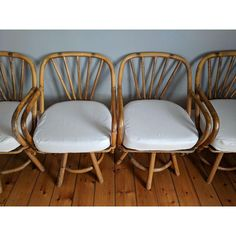 DESCRIPTION  Wonderful set of four swivel dining height bamboo armchairs with linen, ivory seat cushions.