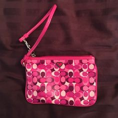 Coach Wristlet small Coach wristlet with hearts. About the size of a woman's hand. great for storing things in a purse! Coach Bags Clutches & Wristlets