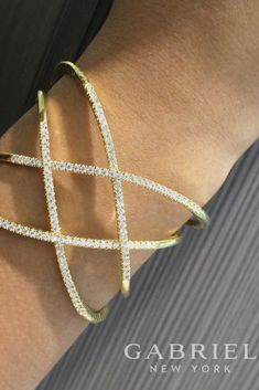 14k Yellow Gold Diamond Bangle. Check this beautiful bracelet out, with almost 1.75 carats full of diamonds, you'll be style the summer fashion in no time!