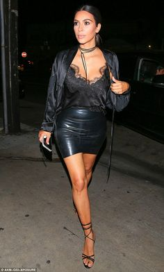 eab8e05932caf Kim Kardashian wears cami and tiny leather mini on date with Kanye