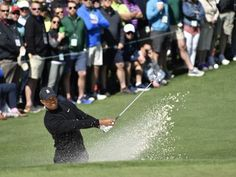 Tiger Woods hits out of a bunker on the 2nd hole during the first round of the Masters golf tournament at Augusta National on April 5. He made par on the hole.  Michael Madrid-USA TODAY Sports