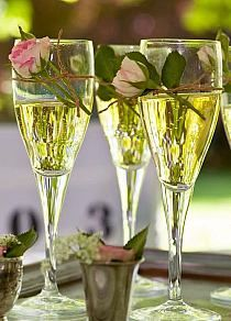 I love the flowers wrapped around the champagne glass