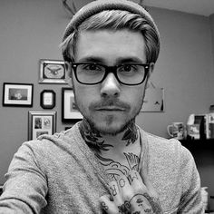 This doesn't really count 'cause there are no stripes but gawd I love a guy in glasses and a beanie. With tattoos.