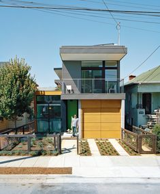 The drought-tolerant garden can be watered with runoff from the roof in this modular home.
