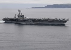 PACIFIC OCEAN (April 3, 2017) The aircraft carrier USS Nimitz (CVN 68) participates in a show of force strait transit exercise. Nimitz is underway conducting a composite training unit exercise (COMPTUEX) with the Nimitz Carrier Strike Group in preparation for an upcoming deployment. COMPTUEX tests a carrier strike group's mission-readiness and ability to perform as an integrated unit through simulated real-world scenarios. (U.S. Navy photo by Mass Communication Specialist Seaman Ian Kinkead)