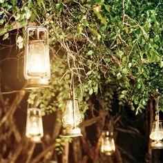 More lovely lanterns. Soft light shines through vintage lanterns hung from tree