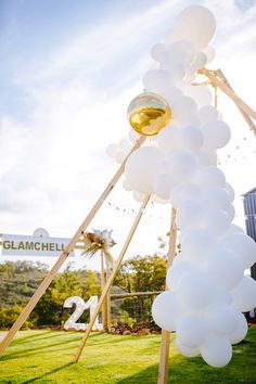 """I'm going crazy for this Glamchella Boho 21st Birthday Party bySassy Snaps, out of Perth, Australia! Sophisticatedly styled with woods and white, this 21 birthday bash is an absolute delight! So scroll on, do not wait and check out these details below:  Wood Glamchella Arch Balloon and Twinkle Light Naked Teepee Neutral-colored + White Guest Table """"21"""" Marquee Light Modern Triangle Signage Barrel Tables  The post Glamchella Boho 21st Birthday Party appeared first on Kara's Party Ideas."""