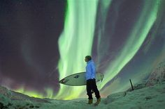 French professional surfer Romain Laulhe takes in the beauty of the northern lights in Norway.