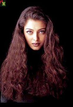 Aishwarya Rai looks amazing with curly red hair!