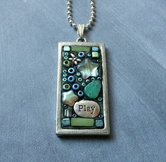 Julie Sweeney - Pendant was made using two-part epoxy clay. Gives me ideas with polymer clay.