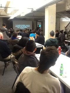 """me, talking to GAFFTA's Art Hackathon crowd, showing a quote by Glenn Bruno: """"A master builder cannot separate his design from the construction"""""""