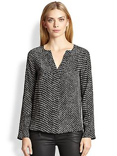 Well, how could you go wrong with a tweed print, Italian silk blouse??