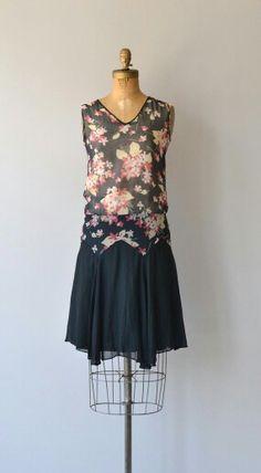 1920s silk chiffon dress with black floral print bodice, V neckline, drop waist, layered silk chiffon skirt and no closures.