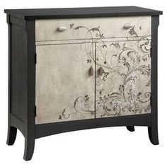"""Featuring elegantly scrolling detailing on its front panels, this alabaster and charcoal-hued cabinet features 1 drawer and a bottom cabinet for stylish storage.  Product: CabinetConstruction Material: Wood and metalColor: Alabaster and charcoalFeatures:  One drawerBottom cabinet  Dimensions: 36"""" H x 38"""" W x 16"""" D"""