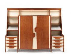 Gio Ponti, wall unit with wardrobe, 1950s. Mahogany wood veneer, lacquered plywood, mirrored crystal and lighting system.