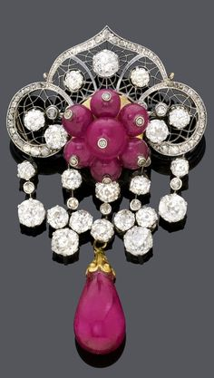 A BELLE EPOQUE DIAMOND AND RUBY BROOCH, BOUCHERON PARIS, CIRCA 1910. A filigree brooch with central flower motif set with seven ruby beads, surrounded by circular- and rose-cut diamonds, suspending five diamond-set pendants and one pear-shaped ruby drop, mounted in white and yellow gold. Signed Boucheron Paris. #Boucheron #BelleÉpoque #brooch
