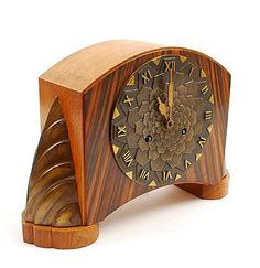 Wooden Art Deco mantle-clock with bronze dial and bronze ornaments on the sides executed by Mundiklok the Netherlands ca.1930