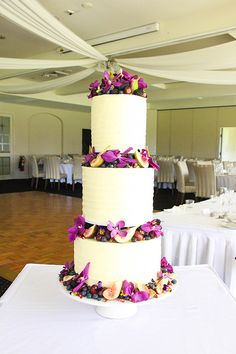 Wedding cake with fresh petals between tiers