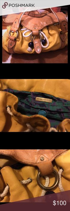 Marc by Marc Jacobs slouchy handbag Marc by Marc Jacobs, yellow distressed leather with drawstring closure. Turquoise & purple printed cloth interior. Great condition, hardly used. Marc by Marc Jacobs Bags Satchels