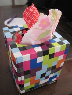 My friend made this for her 1-year-old: tissue box stuffed with fabric scraps so she can have the fun of pulling out Kleenex without all the mess and waste. Great idea!